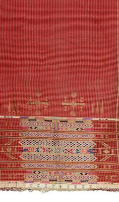 Africa | Shawl from Djerba, Tunisia | Cotton, silk and metallic thread; with a central pattern on white squares on a brick-red background, the lower part richly embroidered with horizontal bands of abstract decoration worked in metallic threads with thin stripes || Partial view ~ detail