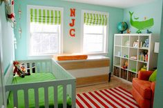 I like the orange and lime green color combo in this nursery