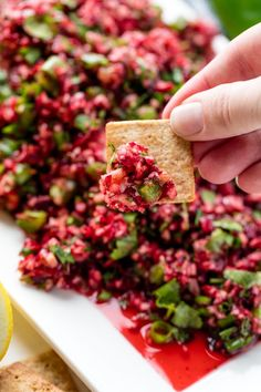 Cranberry Salsa over Cream Cheese-Fresh cranberries are minced up into a healthy, fresh, and vibrant salsa. This Cranberry Salsa is served best over a brick of cream cheese. Holiday Appetizers, Appetizer Dips, Appetizer Recipes, Yummy Appetizers, Cranberry Salsa, Cranberry Recipes, Ceviche, Thanksgiving Recipes, Holiday Recipes