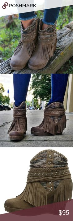 """Wedge Bootie with Fringe Detail These Fringe Wedge Bootie is a must have this season! This wedge bootie is what dreams are made of! An adorable 3 1/2 inch suede leather wedge, wrapped in a colorful knit textile and decorated in fringe! Has 1'' platform as well. Taupe Leather Shaft measures approximately 7"""" from arch Heel measures approximately 3.75"""" Platform measures approximately 1. inches Boot opening measures approximately 13"""" around Fringed, hand crafted design. naughty monkey Shoes…"""