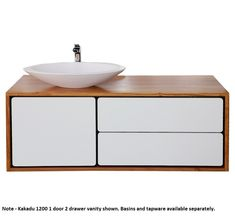 Exclusive to Bathroomware House, the exquisite Momento Kakadu is one of our top of the range solid timber vanities. Constructed in beautiful New Guinea Rosewood (available in other timber species POA), the distinctive modern retro look will create a strong centrepiece for your stunning new or renovation project.