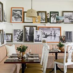 Love the two levels of black and white photos with the punch of color in the frames and seating area.