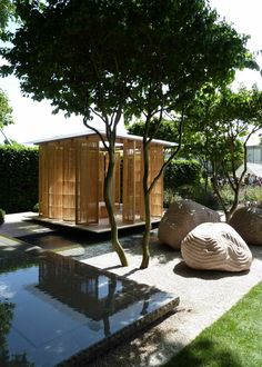 Garden pavilion with rotating screens