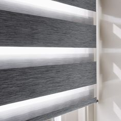 Amazing addition to existing window coverings. Two sliding layers of fabric with sheer horizontal strips. This is the hallmark of Luxaflex® Twist® Roller Blinds, a contemporary addition to existing styles of window coverings. It's an amazingly simple and effective method for choosing just the right amount of incoming light and privacy.
