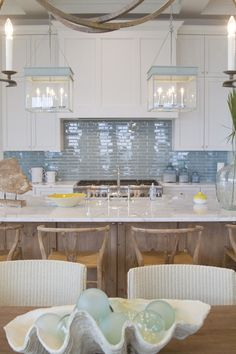 Love, love, LOVE this coastal kitchen! That backsplash... fishing floats & giant clamshell!  Meredith McBrearty - PORTFOLIO - florida beach house