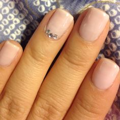 Neutral nails w gems on the ring finger