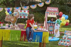 Overlooking the Carnival Party. Decorations, games and food table. #carnivalparty #BirthdayExpresss #kids #party
