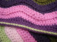 Straight edge on a ripple blanket. I love the slip stitch along the border, too!
