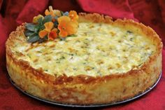 Goat cheese, Fontina & arugula quiche w/ crispy hash brown crust.