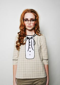 those hipster glasses are ridiculous, but i love the blouse.