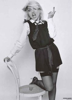 """A great poster of Blondie lead singer Debbie Harry hamming it up for the camera in London in 1978! Ships fast. 24x33 inches. Check out the rest of our """"Atomic"""""""