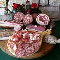 Salumi~ pork products like sausage, salami, ham. Served as an aperitivo with cheese and wine, and good italian bread.