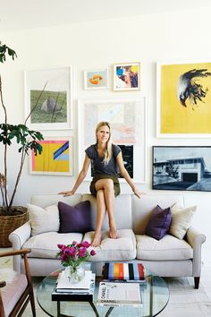 Thanks to their ecelectic art collection, the living room is the most colorful space; the sofa was a gift from Lind's mother.