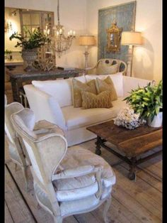Redo couch cover in sitting room white, redo chairs covers cream or taupe velour.  Love vignette & colors blue&gold
