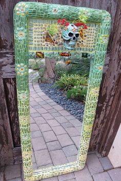 Beautiful mirror. Love it on the fence reflecting a path. Makes it magical. By amazing artist Teresa Marie. Must see her portfolio!
