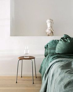 green bed linens. /