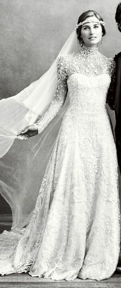 I want a turtle neck gown with little buttons going down and short sleeved with V dips. Vintage lace wedding dress.