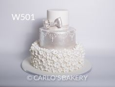 Silver and white blossom wedding cake