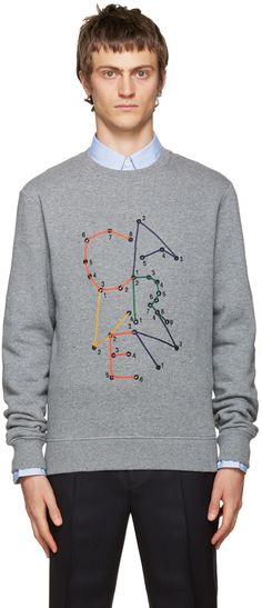 Long sleeve cotton fleece sweatshirt in heather grey. Speckled texture throughout. Rib knit crewneck collar, cuffs, and hem. Embroidered logo featuring eyelet detailing at front. Tonal stitching.