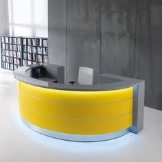 """The Valde   This unique linear or curved reception desk will bring the perfect amount of elegant flair to your office. The Valde Reception Desk stands 114"""" W x 43"""" H x 58"""" D and is available in multiple colors including Canadian Oak, Chestnut, high gloss white, orange and lime. This modular office furniture is flexible and can be configured using wavy, curved, circular, and straight components to suit your reception area and office design."""