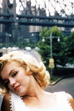 NYC. June 12, 1957. Marilyn near FDR Drive and 59th Street Bridge.