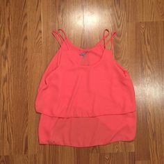 Flowy Tank Top This coral colored tank from Charlotte Russe is adorable with just about everything! The size tag is falling off, but other than that it is a great piece. The material is almost like chiffon. Charlotte Russe Tops Tank Tops