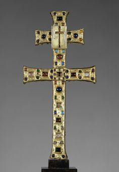 Reliquary Cross, ca. 1180  Made in Limoges, France  Silver gilt, rock crystal, glass cabochons; wood core