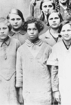 """Rhineland Bastard was a derogatory term used in Nazi Germany to describe Afro-German children of mixed German and African parentage, who were fathered by Africans serving as French colonial troops occupying the Rhineland after World War I. Under Nazism's racial theories, these children were considered inferior to """"pure Aryans"""" and consigned to compulsory sterilization."""