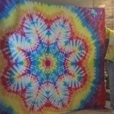 colorfulsteve's channel He has a bunch of tutorials on how to make several different tie dye designs.
