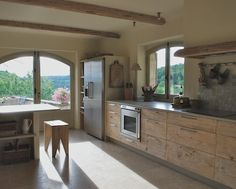 Kitchen cabinets made of old planks that had been used to age big rounds of cheese -- very cool!!