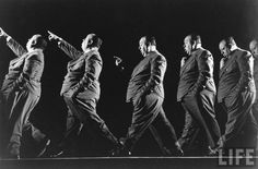 Gjon Mili: Multiple exposure of dir. Alfred Hitchcock walking and pointing into distance during filming of Shadow of a Doubt. 1942, Hollywood