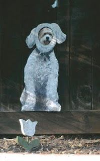 I HAVE to do this for Mason when we get a real house!  He would love it and it is such a cute idea!  You paint your dog on the fence and then cut a hole at their face height so they can watch people go by-