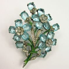 Blue Rhinestone & Enamel Flower Brooch. I have my grandmothers. It is pinks and so pretty.