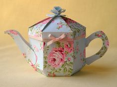 Very cute idea. Paper tea sets would make charming photo props for handcrafted beads and lace. Could get very creative with fine lovely paper.