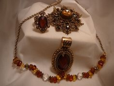 Amber necklace, broach and ring set  $30.00 at Slideshows