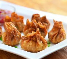 longganisa wontons are deep-fried dumplings filled with longganisa meat, green onions and water chestnuts