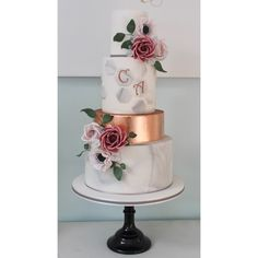 Marble and copper wedding cake by Wish Upon a Cupcake