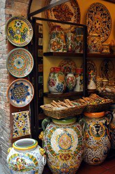 Colorful ceramics lines the shelves at La Bottega, Via S. Tuscan Design, Tuscan Style, Italian Pottery, Tuscan Decorating, Tuscany Italy, Ceramic Pottery, Ceramic Shop, Italy Travel, Decoration