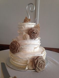 This is how we spend our weekends at Sweet Arleens. Gorgeous Ruffle wedding cake, with burlap roses!