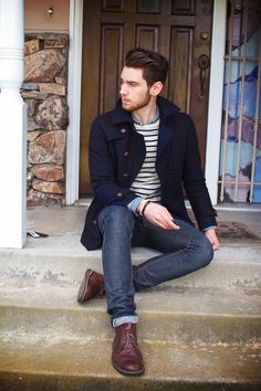 Go for a navy pea coat and navy jeans to create a smart casual look. Finish it off with dark brown leather desert boots.  Shop this look for $256:  http://lookastic.com/men/looks/longsleeve-shirt-and-crew-neck-sweater-and-pea-coat-and-jeans-and-desert-boots/3782  — Blue Longsleeve Shirt  — White and Black Horizontal Striped Crew-neck Sweater  — Navy Pea Coat  — Navy Jeans  — Dark Brown Leather Desert Boots
