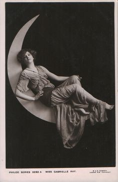 Lovely Miss Gabrielle Ray perches on the moon on a vintage 1920s postcard.