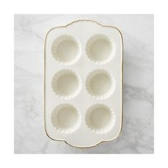 Williams-Sonoma Williams Sonoma Fluted Gold-Rimmed Ceramic Muffin Pan ($25) ❤ liked on Polyvore featuring home, kitchen & dining, bakeware, oven to table bakeware, brown stoneware, cupcake pan, cupcake bakeware and muffin tin