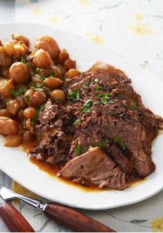 Slow-Cooker Market-Fresh Pot Roast -- Why save pot roast for Sunday? Put it in the slow cooker any weekday morning to enjoy this classic meat-and-potatoes dish after a long day's work.