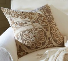 ANITA MEDALLION EMBROIDERED PILLOW COVER--Next to a red pillow--WOW!
