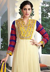 Attract all attentions with this embroidered suit. The dazzling cream faux georgette churidar suit have amazing embroidery patch work is done with resham, zari, stone and beads work. Beautiful embroidery work on kameez is stunning. The entire ensemble makes an excellent wear. Contrasting blue santoon churidar and yellow chiffon dupatta is available with this suit. Slight Color variations are possible due to differing screen and photograph resolutions.