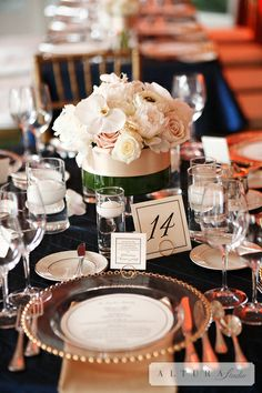 Bridal Bliss Wedding: Low cream, white, and blush centerpiece with gold and navy accents