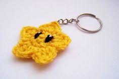 Hey, I found this really awesome Etsy listing at http://www.etsy.com/listing/118906471/super-mario-star-keychain-yellow-crochet