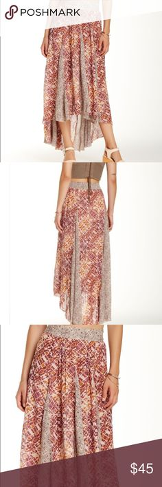 """NWT! Free People long flowy skirt - Smocked back waist - Allover print - Pleated construction - Hi-lo hem - Approx. 30"""" shortest length, 45"""" longest length - Imported Fiber Content 100% rayon Care Free People Skirts"""