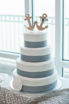 Nautical Themed Wedding Cake /  http://www.deerpearlflowers.com/incorporate-anchors-into-your-nautical-wedding/