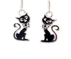 Silver plated, hand-enameled, black cat charms--approximately 0.7 x 0.36 x 0.07 inches (HxWxD) in size, including loop--hang from
